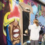 The Freefall youth group bluewash the Phoenix graffiti wall