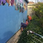 The Freefall youth group bluewash the Phoenix graffiti wall
