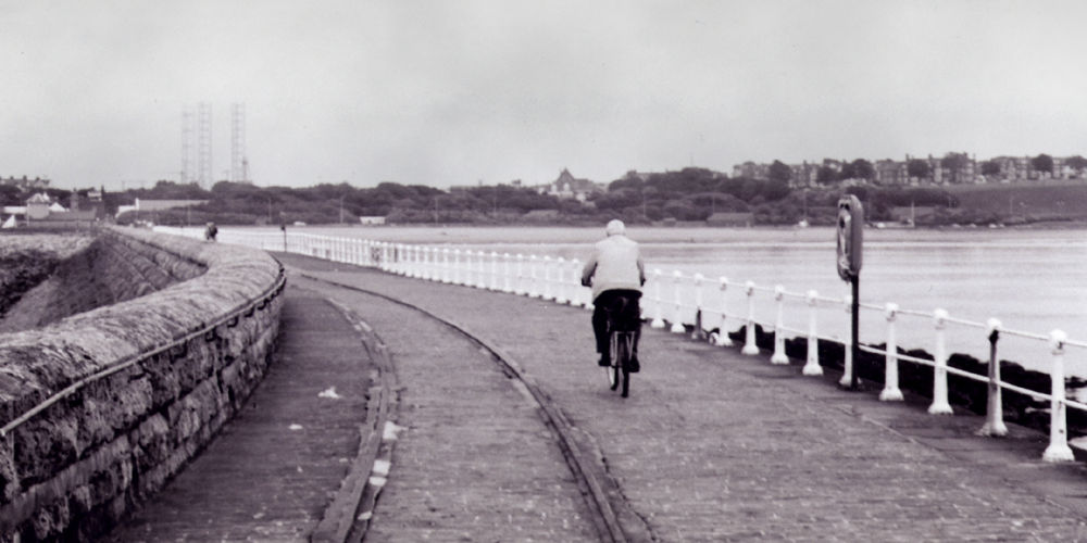 Cycling along the shore. Photo credit: Peter J on FreeImages.