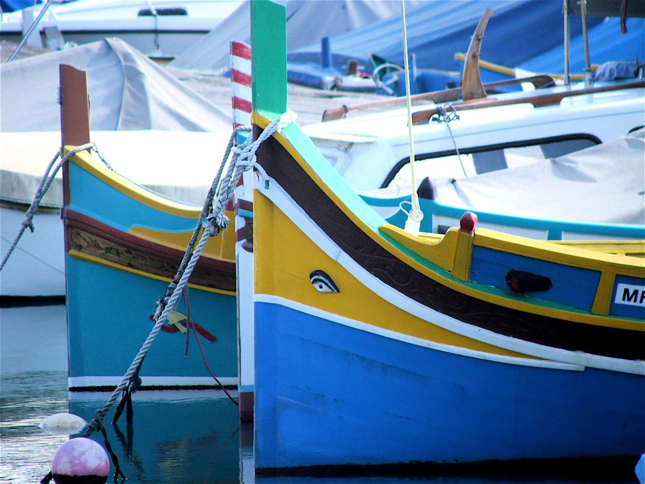 Fishing Boats with Eye of Horus (KNOW MALTA) by Peter Grima from MALTA - FISHING BOATS, CC BY-SA 2.0, https://commons.wikimedia.org/w/index.php?curid=57478646