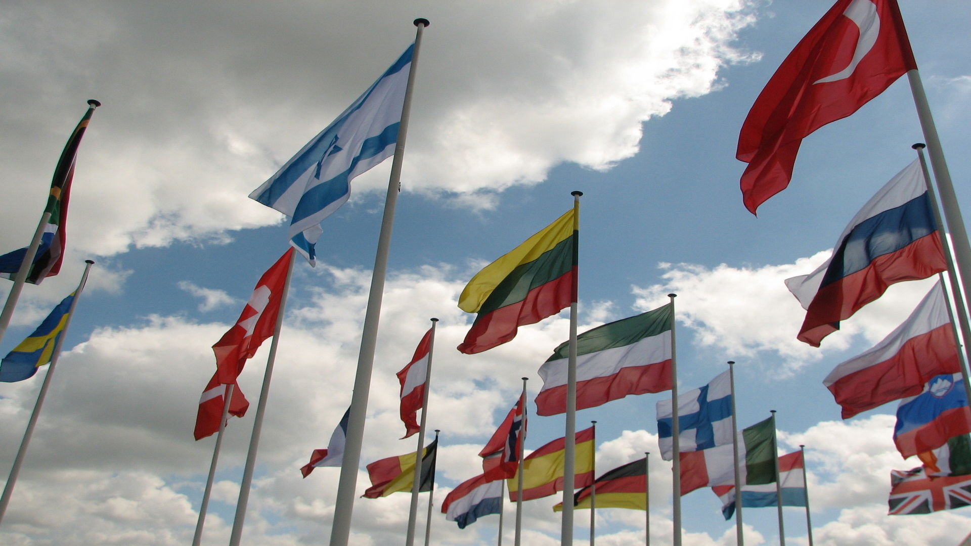 Flags around the world. Photo credit: Tibor Fazakas on Free Images.