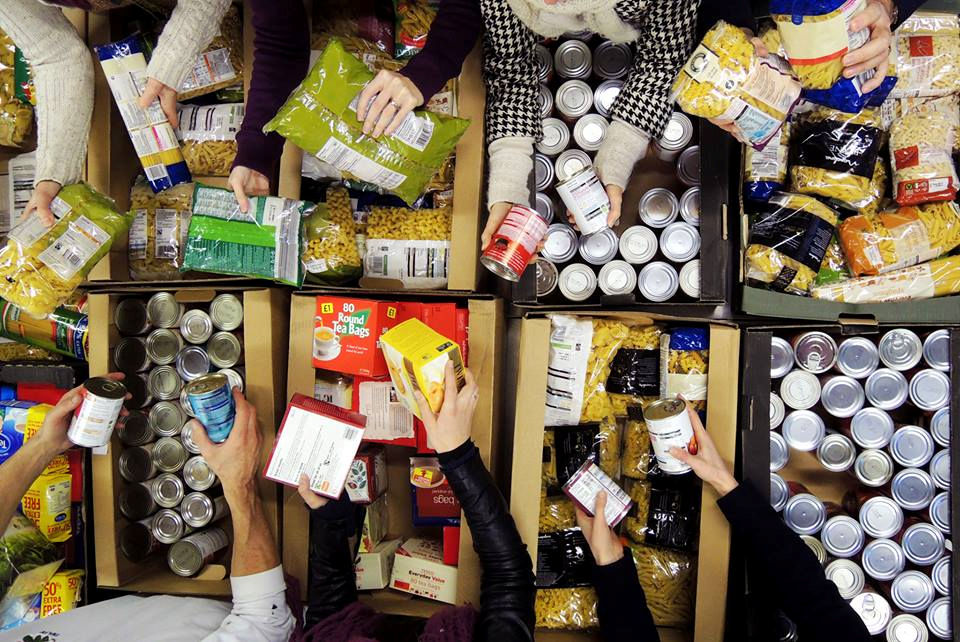 Food sorting. Photo snaffled from Exeter Foodbank website.