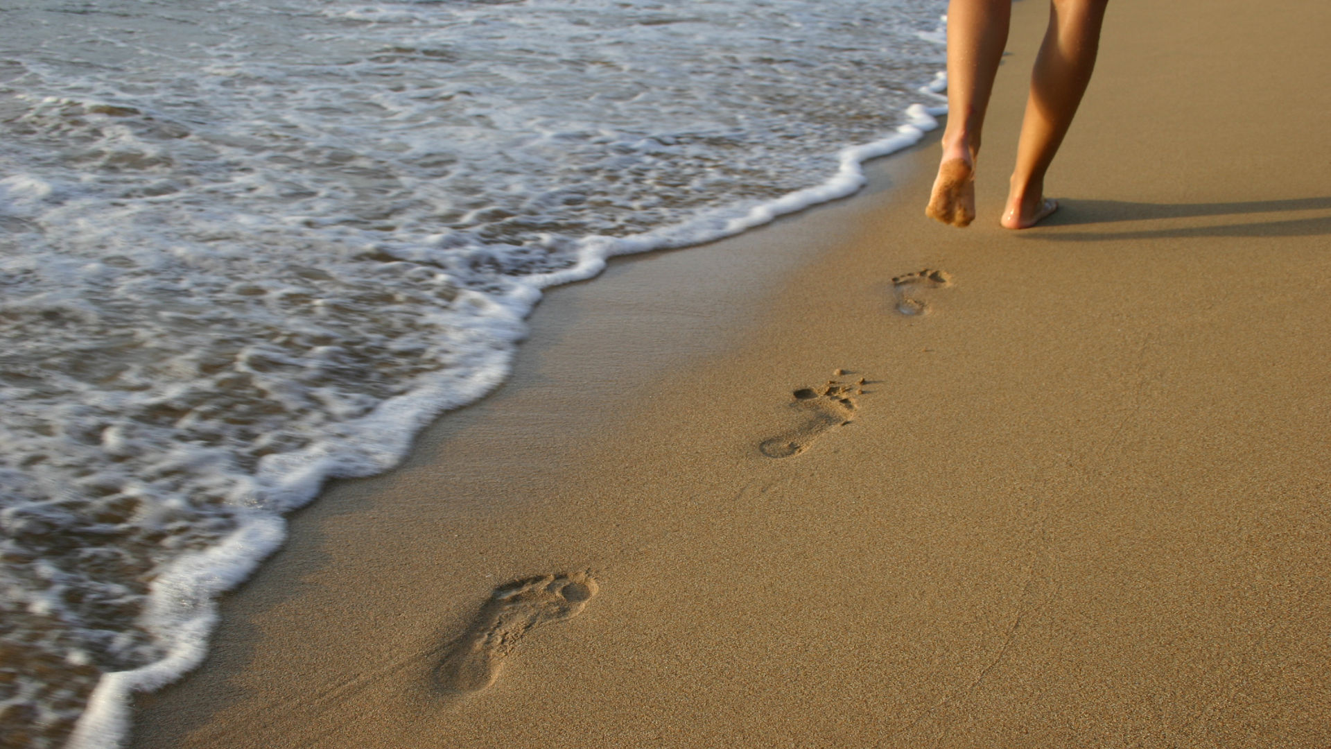 Footprints in the sand. Photo credit: Csongor Varga on Free Images.