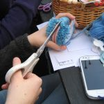 Making pompoms for the Freefall Climate Graffiti woolly wall